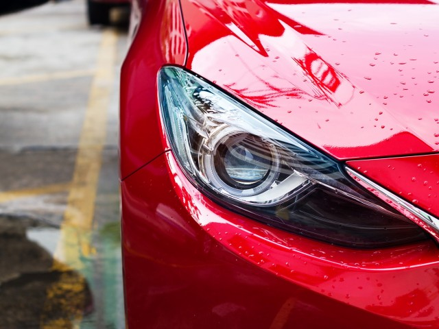 headlights of red car after the rain on street