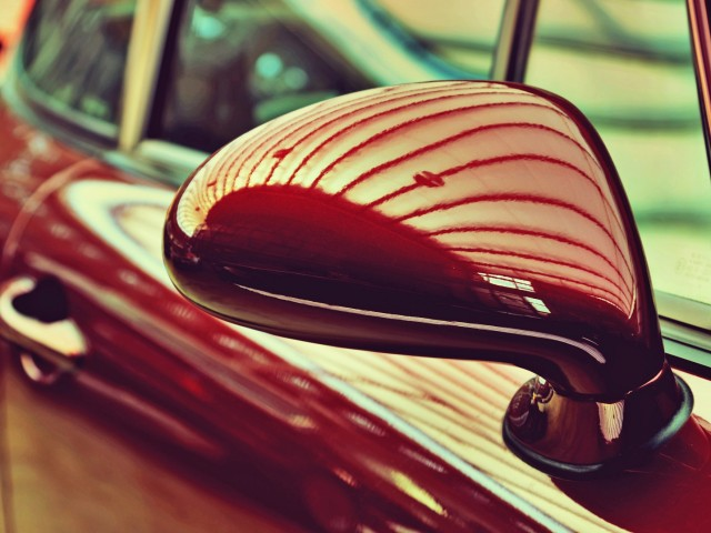 Mirror of the original cherry-old car. Retro style. Sophistication. Elegance
