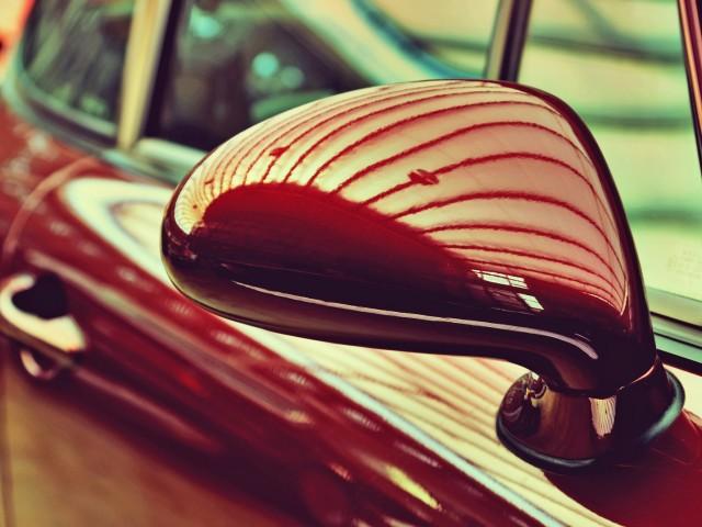 Mirror of the original cherry-old car. Retro style. Sophistication. Elegance